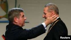Outgoing International Olympic Committee President Jacques Rogge (right) congratulates Thomas Bach of Germany after he was elected the ninth president of the IOC during a vote in Buenos Aires on September 10