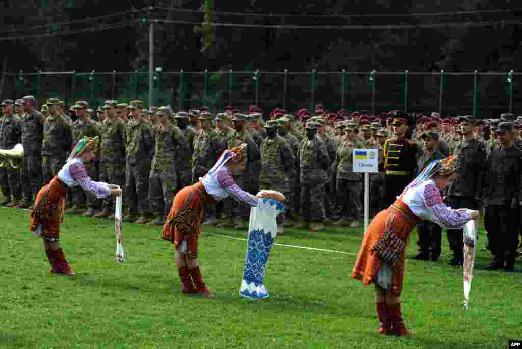 Ukrainian folk dancers perform for Ukrainian and U.S. servicemen in a ceremony for joint exercises between the two countries in Ukraine's Lviv region. The annual Rapid Trident exercises involve 1,800 soldiers from 18 countries. (AFP/Yuriy Dyachyshyn)