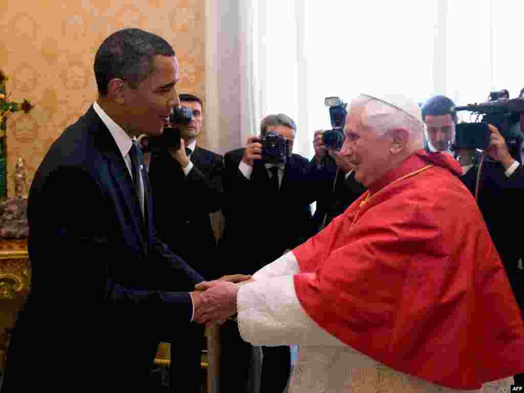 Pope Benedict greets U.S. President Barack Obama (left) during an audience in July 2009.