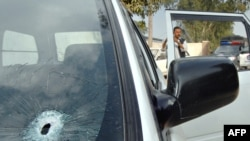The bullet-riddled car of the kidnapped Iranian diplomat in Peshawar