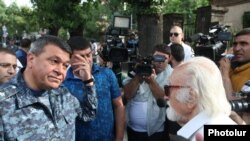 Armenia - Vladimir Gasparian (L), the chief of the Armenian police, argues with a protester in Yerevan, 26Jun2015.