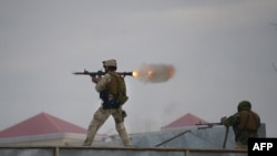 An Afghan Quick Reaction Force (QRF) soldier fires a rocket-propelled grenade (RPG) launcher during an operation near the Indian consulate in Mazar-e Sharif on January 4, 2016