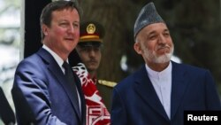 British Prime Minister David Cameron (left) and Afghan President Hamid Karzai (file photo)