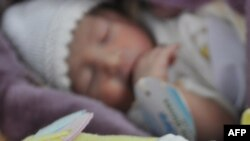 Afghanistan -- Newborn babies are pictures at a maternity ward in the Malalai Maternity Hospital in Kabul, 17Oct2011