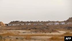 Pamje e luftëtarëve kurdë pas raporteve se i kanë dëbuar militantët e IS-it nga disa fshatra afër qytetit Kirkuk