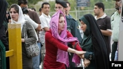In an undated photo, Iranian police warn women about their clothing and hair during a crackdown to enforce Islamic dress code.