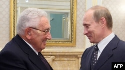 Former U.S. Secretary of State Henry Kissinger meets Russian Prime Minister Vladimir Putin during a visit to Moscow on March 19.