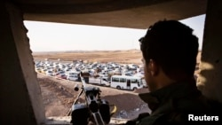 عائلات مغادرة من الموصل بإتجاه أربيل