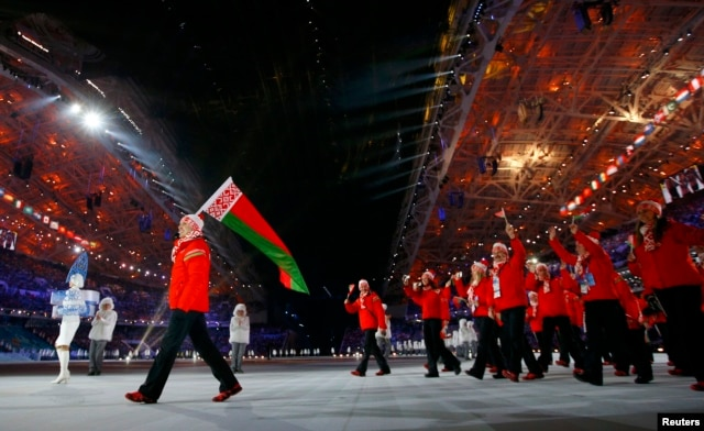 Belarusian flag-bearer Aleksei Grishin leads his country's contingent during the opening ceremony of the 2014 Sochi Winter Olympic Games in February.
