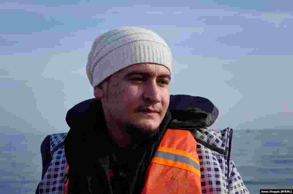 """Syrian refugee Daoud Daoud, 20, after arriving safely on Lesbos. """"We wanted to leave before NATO would close the path,"""" the 20-year-old told RFE/RL once he was ashore on February 28. """"We would rather cross in the summer, but we crossed in winter because NATO has decided to close the way."""""""