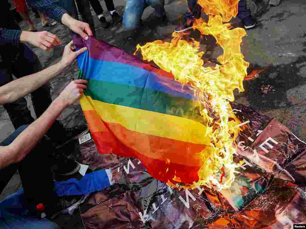 Anti-LGBT protesters burn an LGBT flag during the opening ceremony of Kyiv Pride 2017 in the Ukrainian capital on June 13. (Reuters/Gleb Garanich)