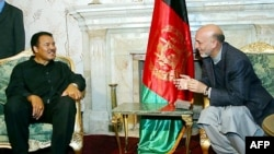 Afghan President Hamid Karzai (right) meets Ali in Kabul in 2002.