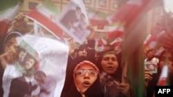 Supporters of Iranian President Mahmud Ahmadinejad celebrate his victory in Tehran on June 14.