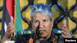 A Libyan rebel minister says Abdel Fatah Younes (pictured), the commander of the rebel armed forces, was killed by an allied Islamist militia.