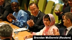 Pakistan - Malala Yousafzai (2nd R), is introduced before her first speech since the Taliban in Pakistan tried to kill her for advocating education for girls, at the United Nations Headquarters in New York, July 12, 2013.