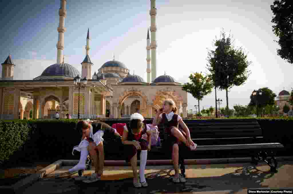 Girls gather after school in front of the Heart of Chechnya Mosque, the largest in Europe. All Chechen girls, regardless of their religion, must wear head coverings in public schools and government buildings.