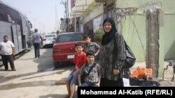أسرة عراقية عائدة من سوريا