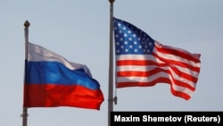 RUSSIA -- FILE PHOTO: National flags of Russia and the U.S. fly at Vnukovo International Airport in Moscow, Russia April 11, 2017.