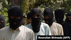 Alleged the Islamic State fighters and Taliban are presented to the media at the police headquarters in Jalalabad, October 3, 2017