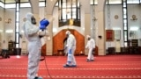 Lebanon - Sanitary workers disinfect a mosque in Beirut on March 5, 2020