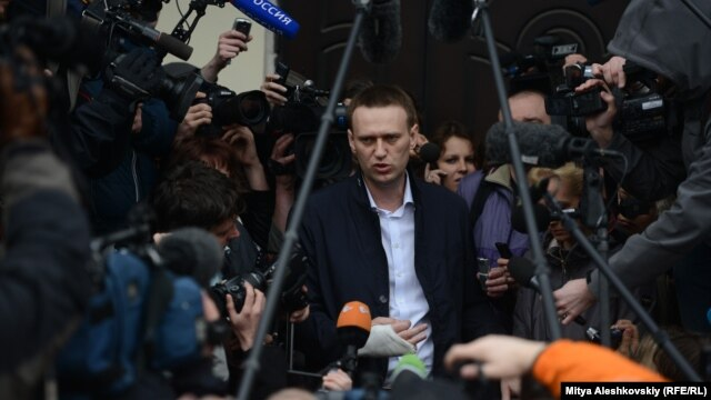 Russian opposition leader Aleksei Navalny speaks to journalists after a meeting of the Kirov city court, which postponed the hearing for a week on charges of embezzlement on April 17.