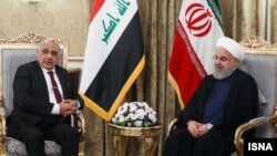 Iraqi Prime Minister Adil Abdul-Mahdi (left) meets with Iranian President Hassan Rohani in July.