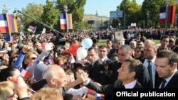 Armenia - French President Nicolas Sarkozy is greeted by people at Yerevan's France Square, 7Oct2011.