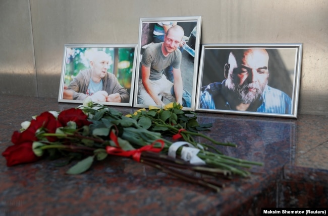 A memorial at the Central House of Journalists in Moscow to the three Russians killed in the CAR.