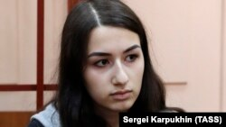 Krestina Khachaturyan, one of three teenage sisters accused of murdering their father, attends a court hearing in Moscow on June 26.