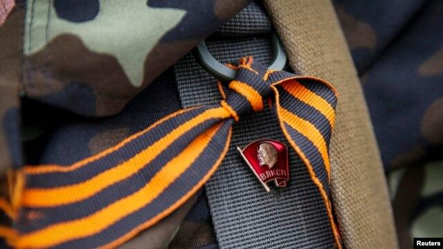 A pro-Russian rebel wears a St. George ribbon.
