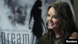 British entertainer Sarah Brightman smiles during an interview in Moscow on October 10, when she announced her plans to travel to the International Space Station aboard a Soyuz spacecraft.