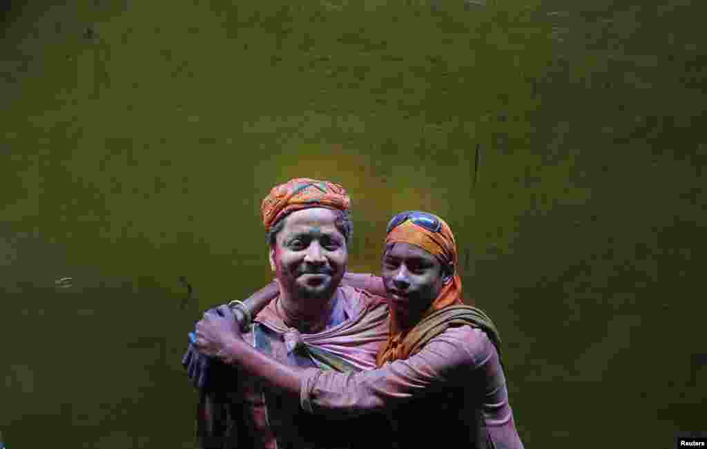 Two Hindu devotees pose for a picture during Holi celebrations in a lane near the Bankey Bihari temple in Vrindavan in the northern Indian state of Uttar Pradesh. (Reuters/Vivek Prakash)