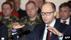 Ukrainian Prime Minister Arseniy Yatsenyuk speaks during a meeting with leaders and representatives of the industrial elite of the region in the eastern city of Donetsk on April 11.