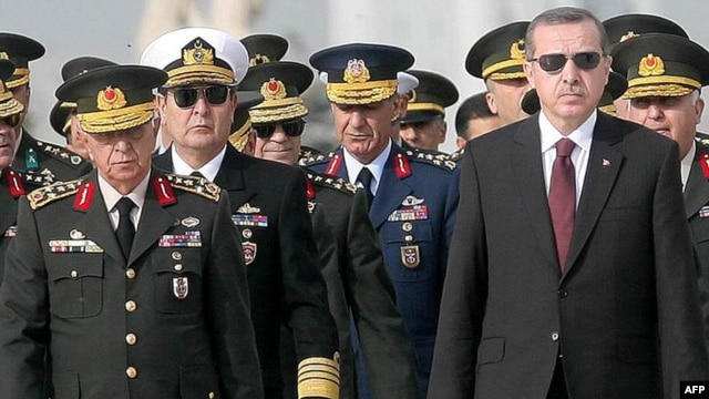 Chief of Staff General Isik Kosaner (left) stands next to Prime Minister Recep Tayyip Erdogan at a wreath-laying ceremony with members of the Supreme Military Council in Ankara last year.