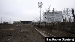 A sign is seen at the Donetsk airport, damaged by months of fighting, on February 26, 2015.