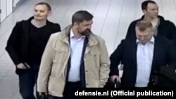 A photo released by the Dutch government purportedly showing four suspected Russian spies who traveled to the Netherlands on diplomatic passports earlier this year.