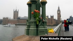 Floral tributes are seen on Westminster Bridge following the attack.