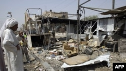 The site of a bomb blast in the Shi'ite neighbourhood of Sadr City in north Baghdad on July 28
