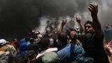 Palestinaly protestçiler öz reaksiýalaryny bildirýärler. 14-nj maý, 2018 ý.
