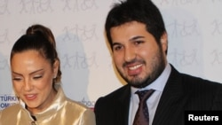 Turkish singer Ebru Gundes with her husband, businessman Reza Zarrab (right), before his arrest