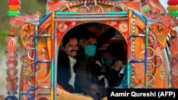 Residents wearing face masks as a preventive measure against the spread of the COVID-19 in Rawalpindi on March 13.
