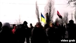 "A screen grab from a live stream from Kharkiv at the scene after a deadly explosion at a ""Dignity March"" on February 22"