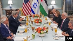U.S. Secretary of State Kerry (center left) hosts the iftar meal at the State Department for Israeli and Palestinian negotiators.