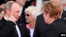 Президент Росії Володимир Путін та канцлер Німеччини Анґела Меркель