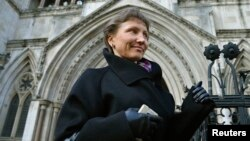 Aleksandr Litvinenko's widow, Marina, who has battled for a full public inquest into her husband's death, leaves the High Court in London in March.