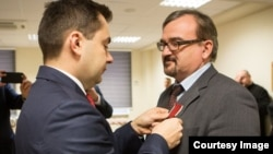 RFE/RL's Minsk Bureau Chief Web Editor with the Belarus Service Valery Kalinovsky receiving the Bene Merito medal at the Polish embassy in Minsk November 17, 2016.