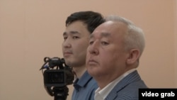 Seitqazy Mataev (right) and his son Aset in court in Astana (file photo)