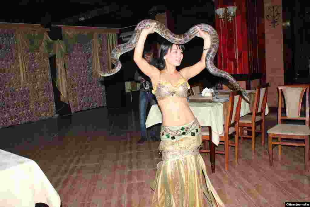 A snake dance in the southern city of Taraz. Kazakhstan has snakes, but not this big.