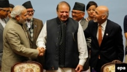 Indian Prime Minister Narendra Modi, left, Pakistani Prime Minister Nawaz Sharif, center, and Afghan President Ashraf Ghani shake hands at a closing session of the 18th SAARC summit in Kathmandu in 2014.