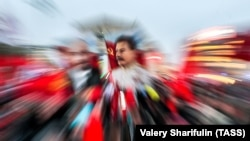 Изображение Иосифа Сталина во время митинга